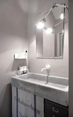 Italian firm b-arch used a reclaimed marble sink to add a note of rusticity in Prato. See A Family Apartment in Italy, Modern Classics Included for more.