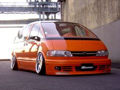 This is one of my favorite body kits I have seen on one yet. I don't like the cambered wheels, but the rest is cool. Mini Vans, Supercars, Toyota Van, Toyota Previa, Vw Sharan, Monospace, Body Kits, Vanz, Chevy Van