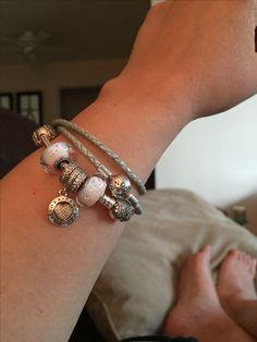 Pandora heart clasp bracelet and baby blue leather bracelet.