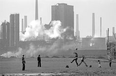 Another for @Brut_Football  I love. Cardiff. Children play football in spare land in front of East Moors steel works.