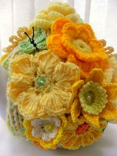 Handknitted handmade knitted by Deb Yellow and orange spring summer garden tea cosy with summer flowers. Detail view with green butterfly Tea Cosy Knitting Pattern, Tea Cosy Pattern, Knitting Patterns, Crochet Patterns, Crochet Geek, Crochet Home, Crochet Crafts, Form Crochet, Knitted Tea Cosies