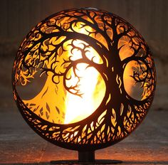 Fireball: The Tree of Life Ellipse firepit is an intricate work of art and it will keep you toasty too Fire Pit Patio, Diy Fire Pit, Outdoor Fire, Fire Pit Sphere, Metal Fire Pit, Fire Pits, Fire Pit Globe, Fire Pit Designs, Scrap Metal Art