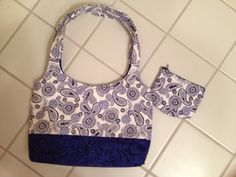 Small blue and white paisley bag with matching coin purse on Etsy for $19.95