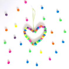 Pipe cleaners + pony beads for the win.  One of Lennon's favorite activities since he was 2 years old is threading pony beads into pipe cleaners. Most of the time we just do it for fun, but other times we decide to keep them and make something with them like a heart! Because #valentineday  #kidartlit