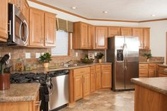 TL806A - Timberland Ranch Kitchen with oak cabinets and Stainless steel appliances