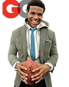 cam newton in Sports jacket, $395 by   Tommy Hilfiger. Hoodie, $65   by Under Armour. Shirt, $325   by Giorgio Armani. Tie, $170,   by Salvatore Ferragamo. Pocket   square, $8 by The Tie Bar.   Pants, $231, by J Brand.