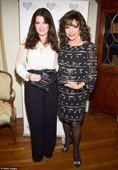 Ladies who lunch: Lisa Vanderpump and Joan Collins were both keeping the British end up on Thursday when they attendedthe UKares Foundation's A Very British Winter Wonderland Awards in LA