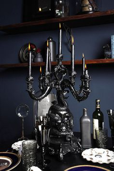 Large black candle holder with skulls and serpents