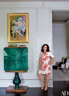 Lisa Cohen, an editor at DuJour magazine, stands in the living room of the Manhattan pied-à-terre she shares with her husband, James, chairman of Hudson Media. Structural work was done by VLArchitects, and Susanna Maggard Interiors oversaw the decor. Next to Cohen is a Willem de Kooning painting and a 1960s bar cabinet by Aldo Tura.