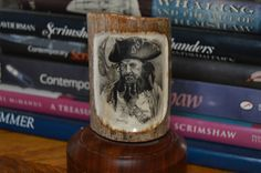 """This piece of mammoth ivory was scrimshawed by Darrel Morris in 2011.  The piece is titled """" The Pirate """""""