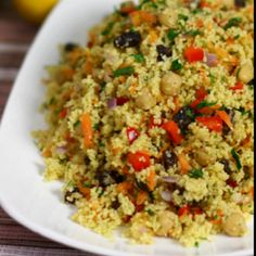 An exotic Moroccan couscous salad with chickpeas, raisins and vegetables coated in a delicately spiced olive oil and lemon dressing.