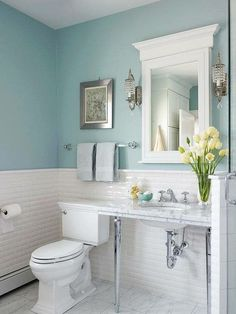 Love the light feel, tile half way all around and color is beachy restful