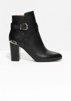 The luxe finish of these leather boots are contrasted by a chunky block heel and gold-tone details.