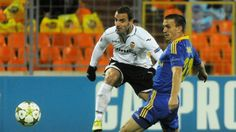 Roberto Soldado scores one of his three goals for vs BATE Borisov to lift Valencia to a 3-0 win in their UEFA Champions League group stage match.