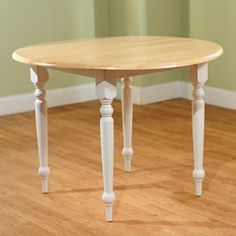 @Overstock - Update your dining decor with a round drop-leaf table  Round double drop-leaf table is cozy for two and roomy enough for added guests  Table lets you extend two 7-inch leaves, giving this table a 40-inch diameterhttp://www.overstock.com/Home-Garden/Rubberwood-40-inch-Diameter-Round-Drop-leaf-Table/3545815/product.html?CID=214117 $132.29