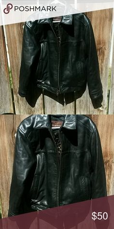 Leather jacket Heavy. ... will need an upgraded shipping label.  Never worn Jackets & Coats