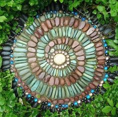 garden stepping stones: Mix up a batch of mortar (which is cement mixed with an aggregate), pour it into a mold (foil pan), then decorate with shells, sea glass or beach pebbles, and let dry. Easy!