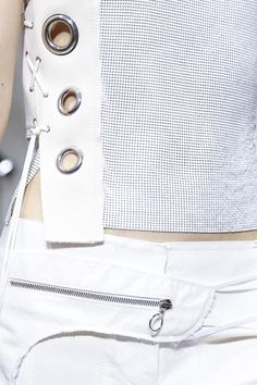 Sporty fashion details with white laces, large eyelets & zipper pocket // Paco Rabanne S/S 2015
