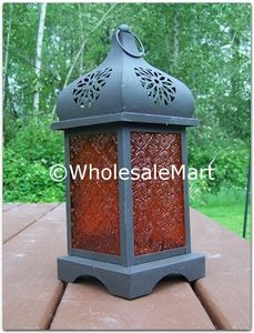 $13.92 Wholesale Sunset Temple Moroccan Lantern  @ http://www.wholesalemart.com/Wholesale-Candle-Lanterns-s/294.htm -   Like a temple tower at sunset, the pressed glass panels of this metalcraft lantern blaze with a mystical desert glow. Simply set a candle inside to set the scene for after-dark magic!