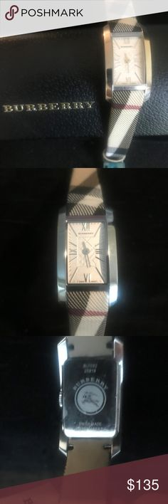 "Authentic Burberry Ladies Nova Check Watch Never Worn!  Battery Working!  Swiss Made.  1 1/2"" H x 3/4"" W ( True Ladies Size)  Rectangular Stainless Steel Case with Genuine Burberry Nova Check Coated Fabric Strap with Leather Backing.  White Dial with Check Detail and Stainless Steel Applied Indexes.  2 Hand.  Deployant Clasp to Save Wear and Tear on Strap.  Scratch Resistant Crystal.  Water Resistance 30 Meters.  Style # BU1062.  Original Box Not Available.  Generic Wooden Gift Box Available…"