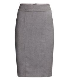 Knee-length pencil skirt in woven stretch fabric. Slightly wider waistband with decorative seams. Slit and concealed zip at back. Lined.