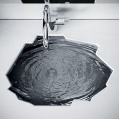 Cool faucet and look how the sink bowl is cut! Really cool sink! :D