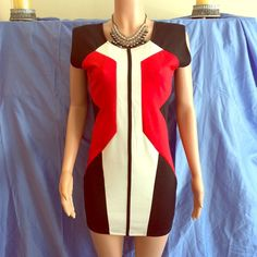 "Body hugging Red, White, Black Dress Beautiful lines and hot colors in this body hugging dress.  Size says XL but on the mannequin which is a size 6 it fits pretty well, please look at measurements before to make sure it will fit.  17"" armpit to armpit, 15"" across waistband, 16.5"" across hip, 28"" length down from black line.  Lycra stretch fabric, 95% polyester 5% spandex.  Some light padding in shoulders to keep shape.  Price final except with bundle discount.  Perfect piece to look  this…"