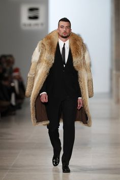 Model walks for Nuno Gama...so casually that you wonder whether he's aware of his great fur.