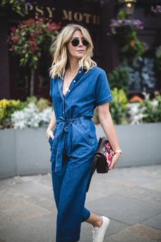 Emma Hill wears denim jumpsuit, floral handbag, YSL trainers, casual summer outfit