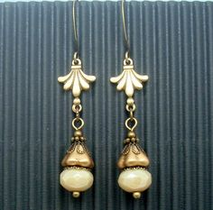 $22 I made these bohemian earrings with complex neutral colors and a fleur de lis victorian brass charm. They are long, but light and pleasing.