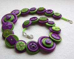 Button Bracelet http://www.etsy.com/listing/84709394/purple-and-green-button-necklace?ref=sr_gallery_7&sref=&ga_search_submit=&ga_search_query=purple&ga_order=most_relevant&ga_ship_to=ZZ&ga_view_type=gallery&ga_search_type=all&ga_facet=