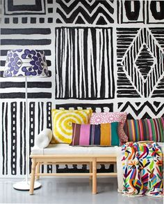 Graphic black and white painted wall panels look as if they were inspired by African art