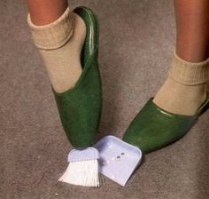 Broom and Dustpan Slippers. You'll never have to bend over again. Prevents achy backs or are they totally pointless?