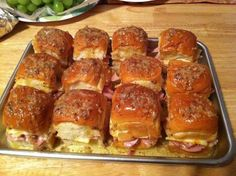 BEST DARN HAM SANDWICHES YOULL EVER HAVE!!! 2 -12 packages of sweet Hawaiian rolls (the small dinner roll looking ones)  11/2 lbs of Virginia ham (NOT honey ham)  12 slices Swiss cheese  1 stick of real butter 2 teaspoons Worcestershire sauce  1 teaspoon Garlic Powder 1 teaspoon Onion Powder 1 teaspoon poppy seeds Directions: You will need two 9 x 13 pans. Place the bottoms of 12 rolls in each pan. Place ham (about 2 shaved slices or so) on the rolls. Cut the cheese slices into 4 pa