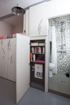Armario oculta cuarto de baño y cama
