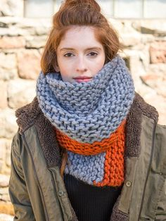 Knit lengthwise in garter stitch, this super bulky cowl works up quickly in two colors.