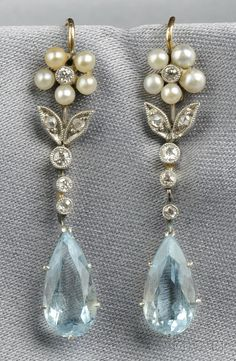 "Aquamarine, Seed Pearl, and Diamond Earrings: pretty! has white and a light blue if you go with the ""something old..."" thing.."