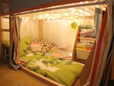 """M4's bed, however, use a tension rod, to make the curtains.   The twinkle lights are too girly for him, but I will think of some other lighting options for his """"reading"""" area.    IKEA bed."""