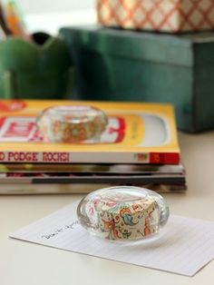 DIY paperweights from glass candle holders.