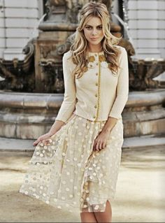 Definitely needs to be a different color but I like the style of this skirt with an embellished cardigan