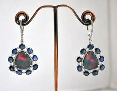 Stunning Boulder Opal Earrings with Diamond and Sapphire Accents, set in 18kt Gold.