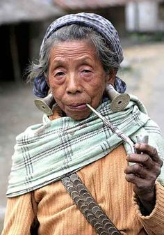 India | Digaru Mishmi lady smoking a pipe.  Arunachal Pradesh | ©Christa Neuenhofer