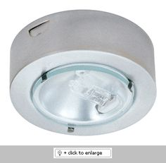 """Mini Surface Mount Downlight with Clear Lens   Downlight with 1 3/4"""" reflector and protective lens.    ETL Listed for remote transformers  Lamp: 12V 20W JC lamp (included)    Dimension: Height: 7/8"""", Cutout: 2 1/4"""", Trim O.D.: 2 5/8""""  Regular price: $19.99  Sale price: $11.99"""