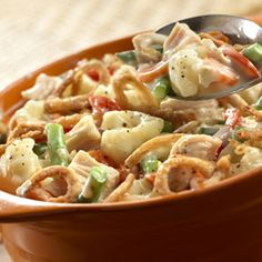 Chicken and Vegetable Bake    This tasty one-dish casserole uses canned chicken, colorful vegetables and crunchy fried onions to help you get a delicious dinner on the table in less than an hour!