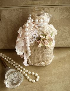 adorned with burlap, lace, cheese cloth, faux pearls, a mulberry paper flower, and is dripping with curly seam binding in palest pink.
