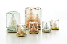 Turn old jars into snow globes for Christmas.