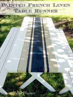 Love the idea of a painted surface on a picnic table that is beautiful and functional