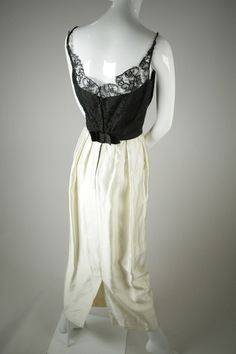 Couture-quality, elegant black French lace top over a rich cream Dutch silk satin skirt. Elegant 1960s evening gown.