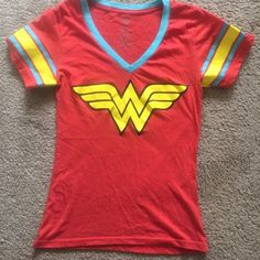 Wonder Woman T-Shirt size Large Worn only three times! Great to wear when you are feeling WONDERful! Tops Tees - Short Sleeve