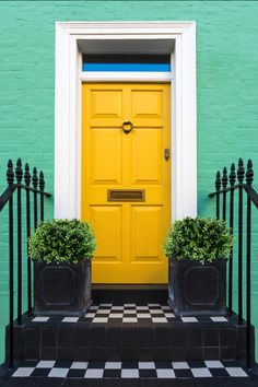 Ready to choose a front door color? From bright shades like yellow front doors and bright orange front doors to more understated colors like hunter green or royal purple front doors, we'll walk you through how to choose the perfect paint color for your bright colorful front door that adds instant curb appeal and charm to your home's entryway. Hadley Court Interior Design Blog. #frontdoorcolor